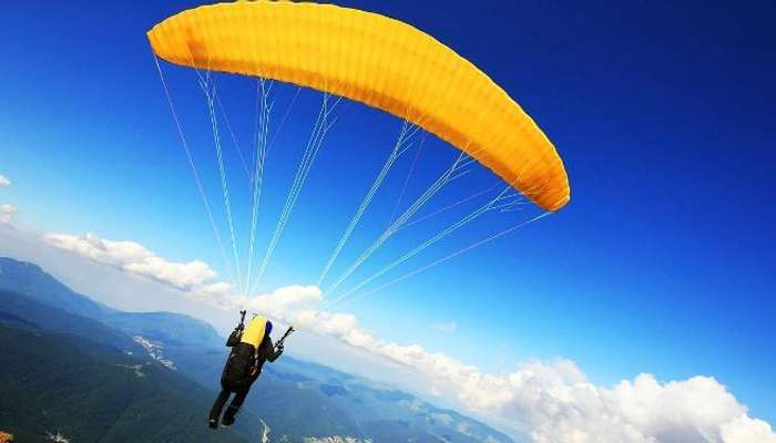 A paraglider in the beautiful valley of Manali