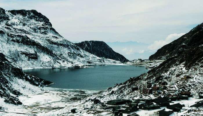 Snow covered peaks surrounding the Tsomgo Lake