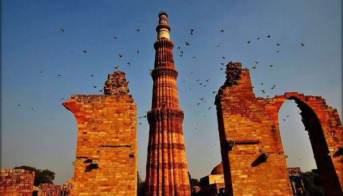 """10 """"Most Beautiful Places Of INDIA"""" That Prevent For Visitor In 2019 Wings taking on to the Qutub Minar"""