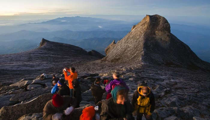 Several hikers at Mount Kinabalu is among the best places to visit in Malaysia for hiking
