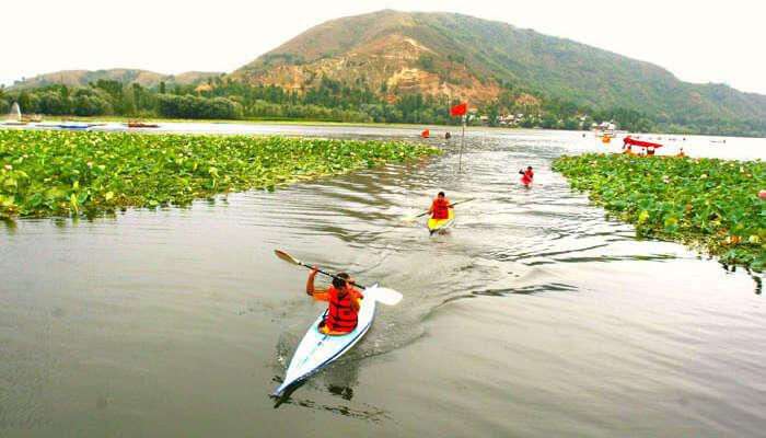 People kayaking at Manasbal Lake in Jammu & Kashmir