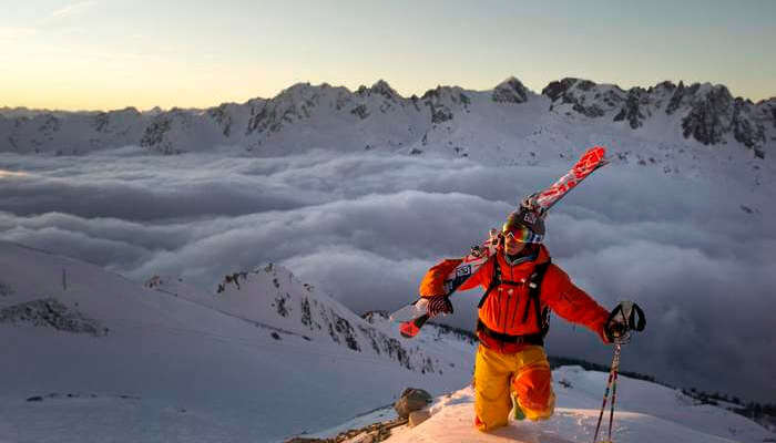 A skier all set to ski in the Alps