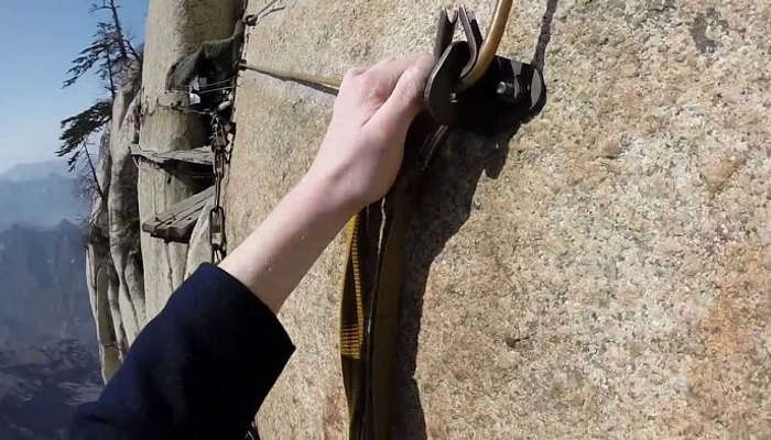 Focus and harness are required to hike Mount Huashan