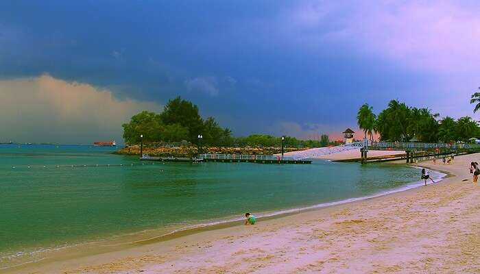 The beautiful tranquil expanse of Siloso Beach which is the most buzzing beach of Singapore