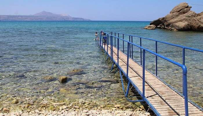 The shallow waters of Almyrida Beach is perfect for kids and non-swimmers to splash around