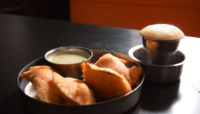 Crispy Bhajis are served with chutney and filter coffee