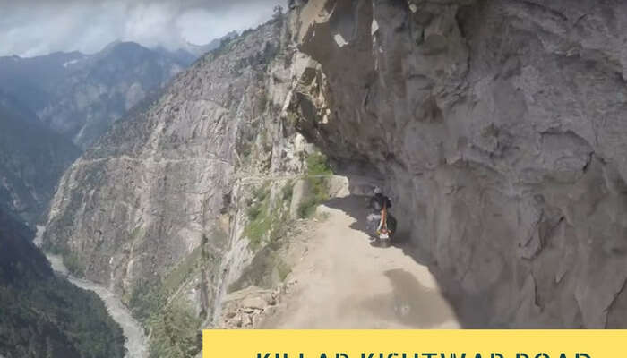 The narrow road with low overhanging cliff and no guardrails on the Killar - Kishtwar route
