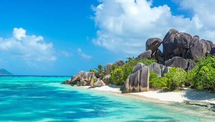 Granite rocks at beautiful beach on tropical island La Digue in Seychelles