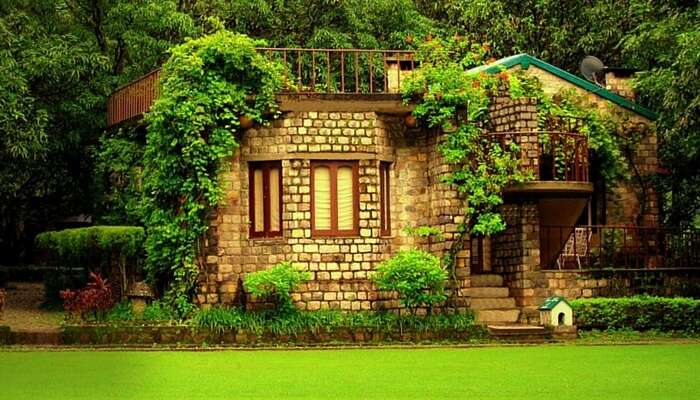 A lovely cottage facing a lush garden at The Den Corbett