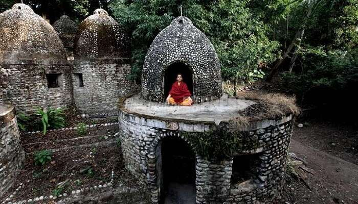 A person meditating at the Beatles Ashram that is one of the most popular places to visit in Rishikesh