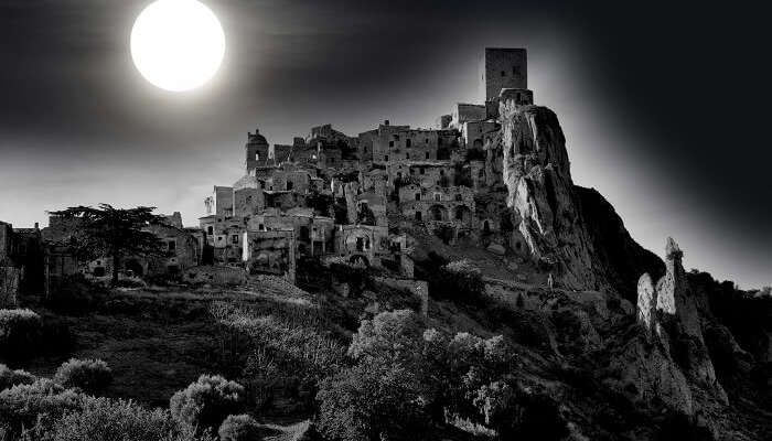 Craco in the moonlight, an abandoned village in Basilicata in south of Italy