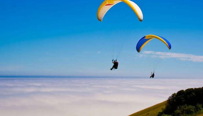 Tourists enjoying paragliding