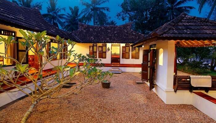 Well-lit villas of Philipkutty Farm in Kumarakom region in Kerala