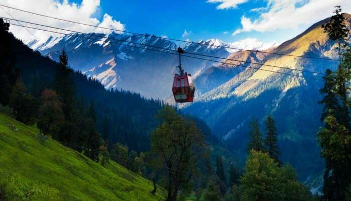 Enjoy the stunning snow capped vistas of Manali on a Gondola Ride