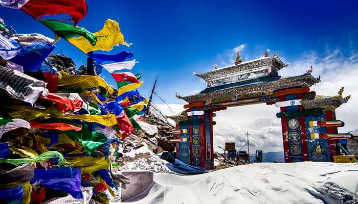 prayer flags near Tawang gate which is covered by snow