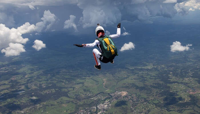 A woman skydiving that is one of the adventurous things to do in Australia