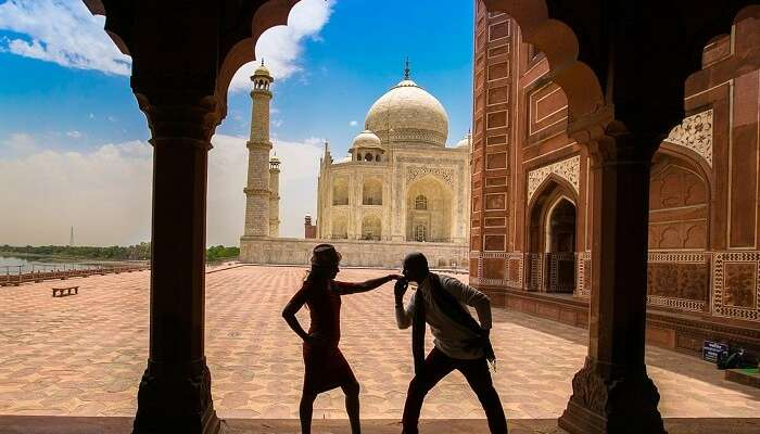 A couple during a photo shoot at Taj Mahal on their honeymoon