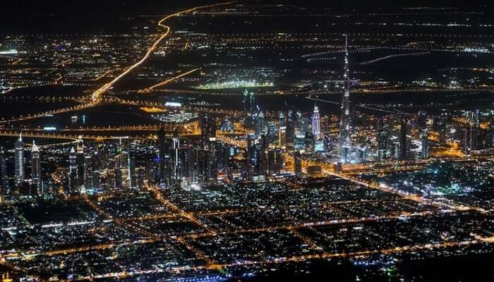 Top view of Dubai city from a helicopter at night