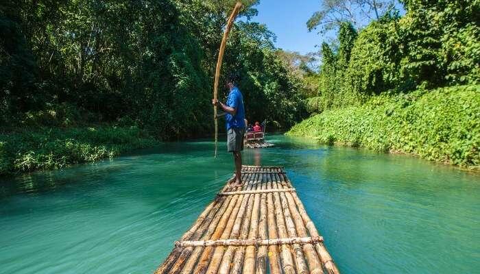 Traditional bamboo boat sailing on Rio Grande River