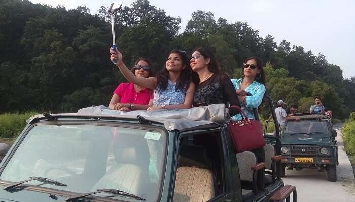 Girls taking selfie during a jeep safari in Jim Corbett