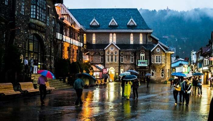 Locals and tourists walking on the Mall Road in Shimla in the rain