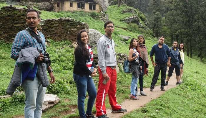 A group of travelers hiking in the Tirthan Valley