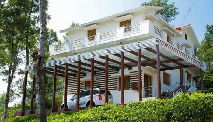 A car parked in front of LMF Paradise Villa in Ooty
