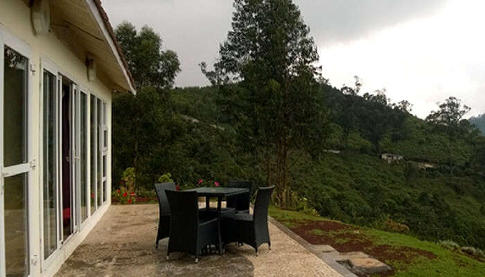 Private seating area of Rohan Villa overlooking a balcony in Ooty