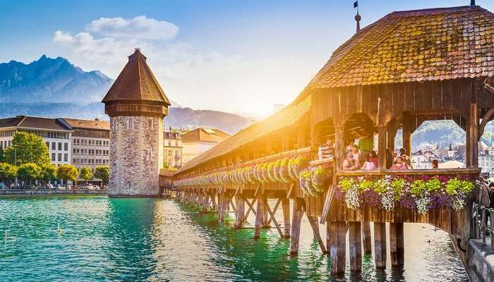 Historic city center of Lucerne with famous Chapel Bridge and Mount Pilatus summit in the background