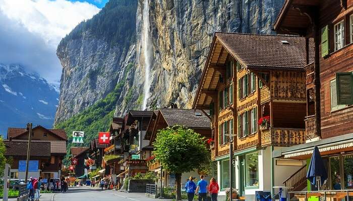 Spectacular principal street of Lauterbrunnen in Interlaken with stunning Staubbach waterfall in background