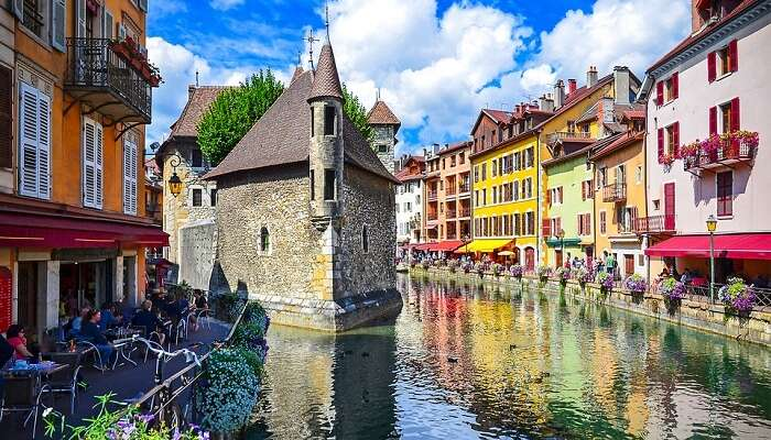 A view of the Palace Annecy by the river at Annecy in France