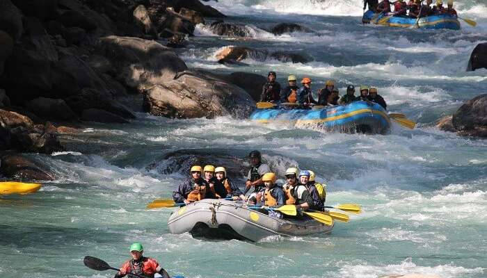 Rafting boats moving together in a stream in Trishuli River in Nepal