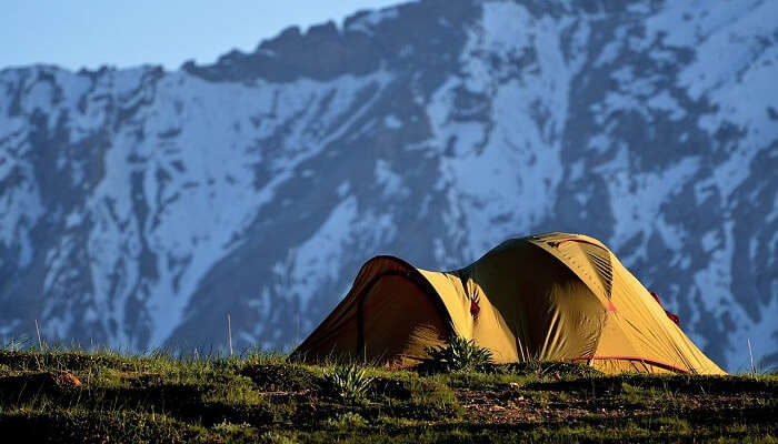 A yellow camp in the mountains