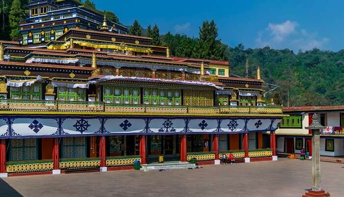A view of Rumtek Monastery in Sikkim surrounded by greenery