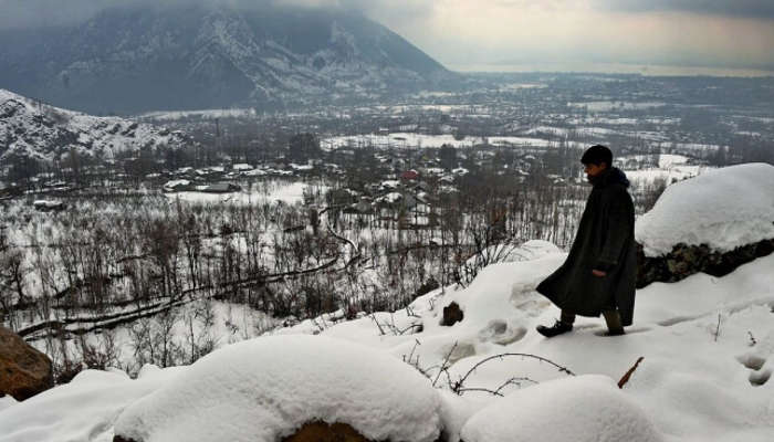 Local kid post snowfall in Kashmir