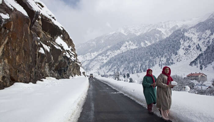 Locals during snow in Kashmir