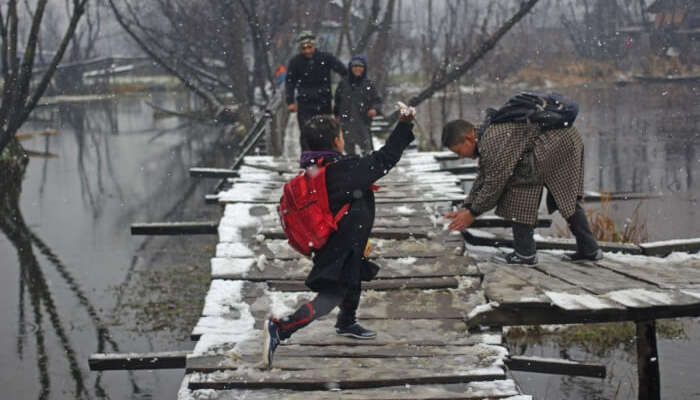 School girl enjoying fresh snowfall in Kashmir 2017