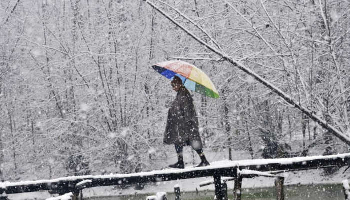 Local during snowfall in Kashmir