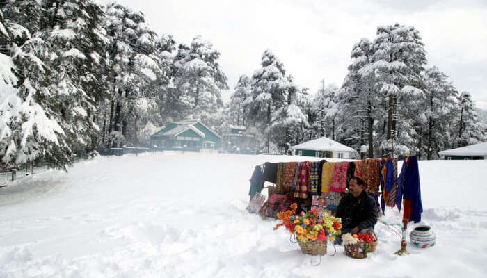 shopkeeper during snowfall in Kashmir