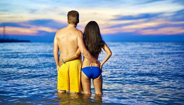 a couple in water in beach