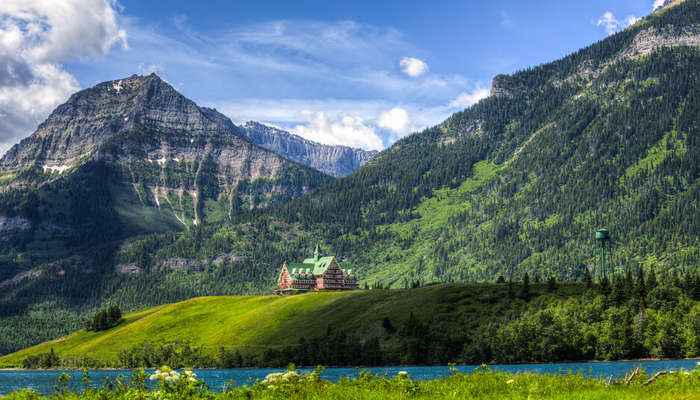 a wooden house amid Waterton Lakes National Park