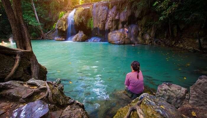 Women sitting near the water