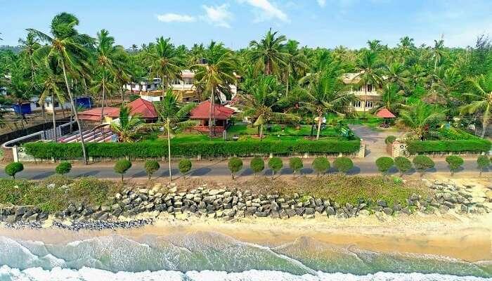Ashokam Beach Resort with a grand lawn and beach views ss