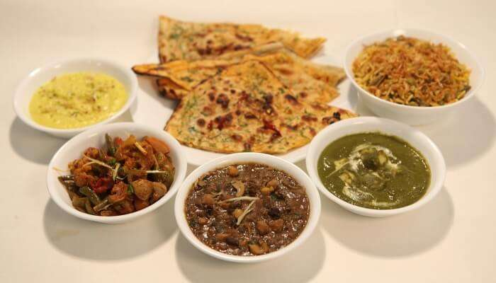 variety of dal served with breads