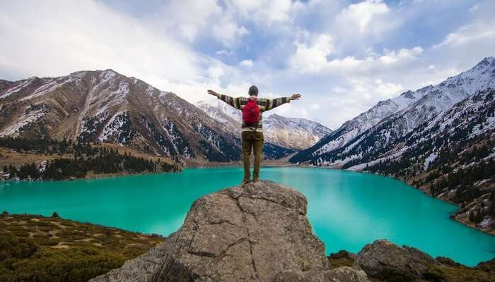 man standing near Almaty lake