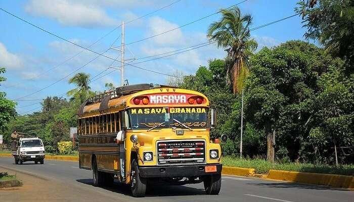 yellow coloured bus