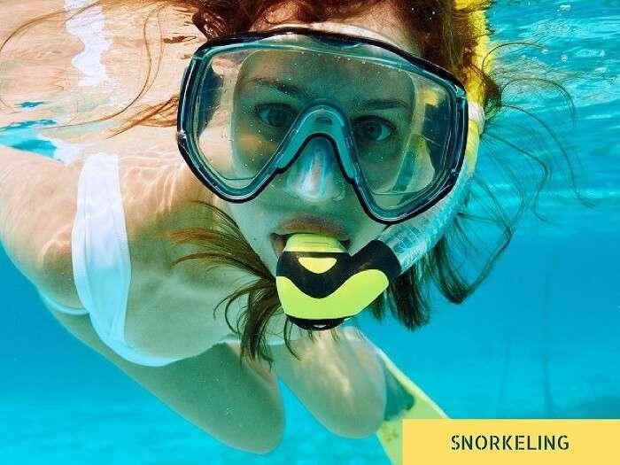 A woman goes snorkeling in Seychelles