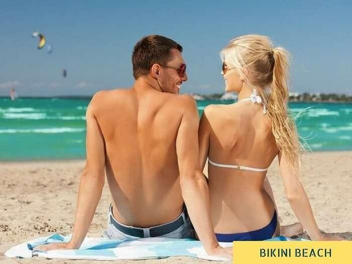 A couple enjoying the sun on the Bikini Beach in Maldives