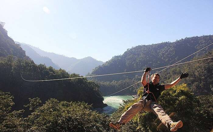 A person trying flying fox in Rishikesh