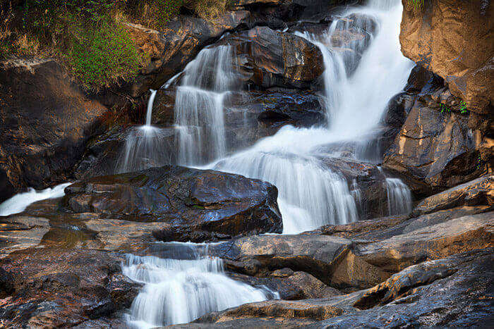 The mesmerisingly flowing Attukad falls in Munnar, one of the significant places to visit in Munnar